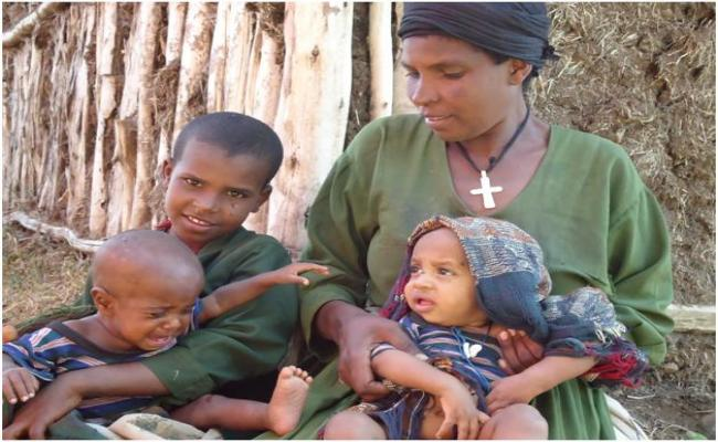 Assefash Metese and her family at a distribution site in Ebinat, Amhara Region