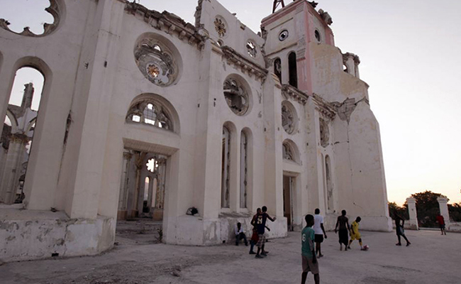 Children play football in the ruins of Notre Dame Cathedral, Port-au-Prince