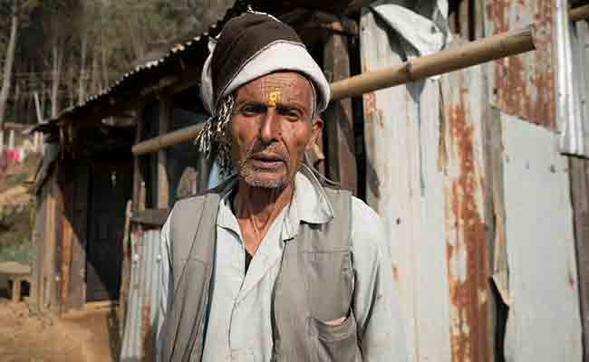 Khadanand Bhatta outside his newly repaired home