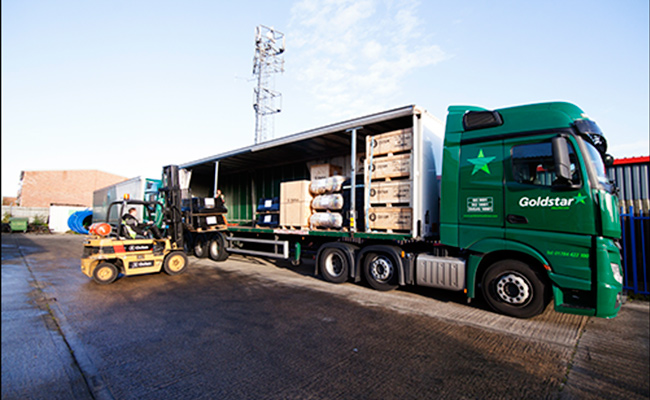 Aid being loaded onto lorries from  Oxfam's distribution centre in Bicester UK