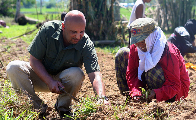Chadra prepares land to grow vegetables, this DEC funded scheme enables vulnerable families to earn an income.
