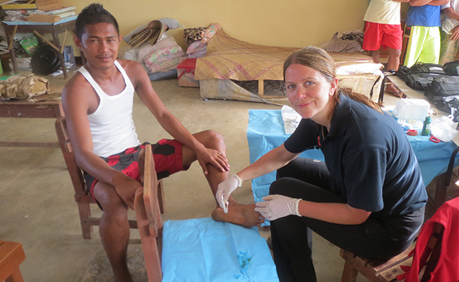Deborah Lau, one of Merlin's medical experts treats a Typhoon survivor on Panay
