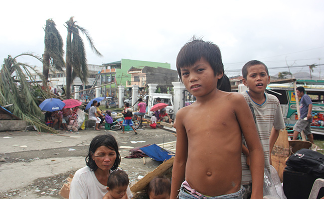 Rafael is 10, and lost his father to Typhoon Haiyan after staying with him to protect the family home