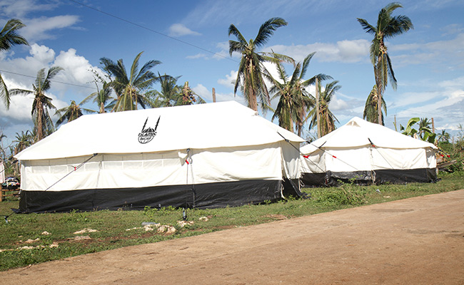 Tents set up by Islamic Relief on the Island of Botigues Philippines & Delivering relief supplies | Disasters Emergency Committee