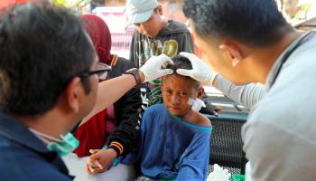 A boy receives treatment following the earthquake