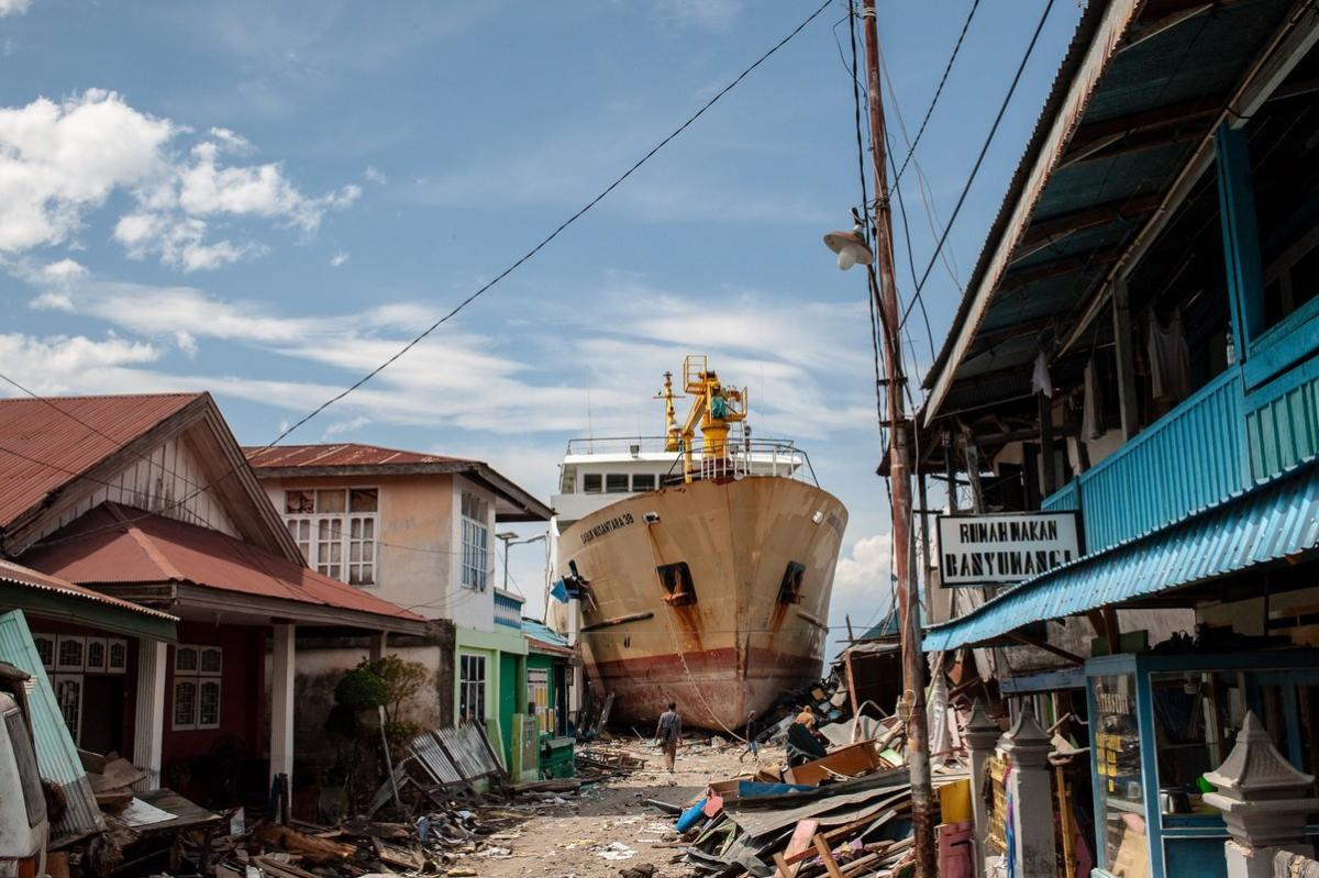 A ship washed ashore by a tsunami sits in the street