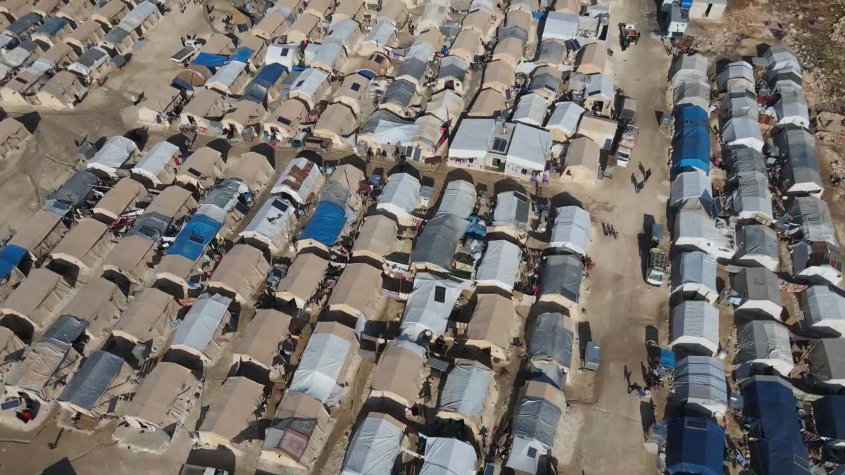 An aerial view of a displacement camp in Syria showing rows and rows of tents